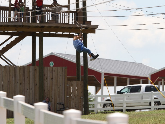 Leslie Moore Zip Lining at the Orr Family Farm